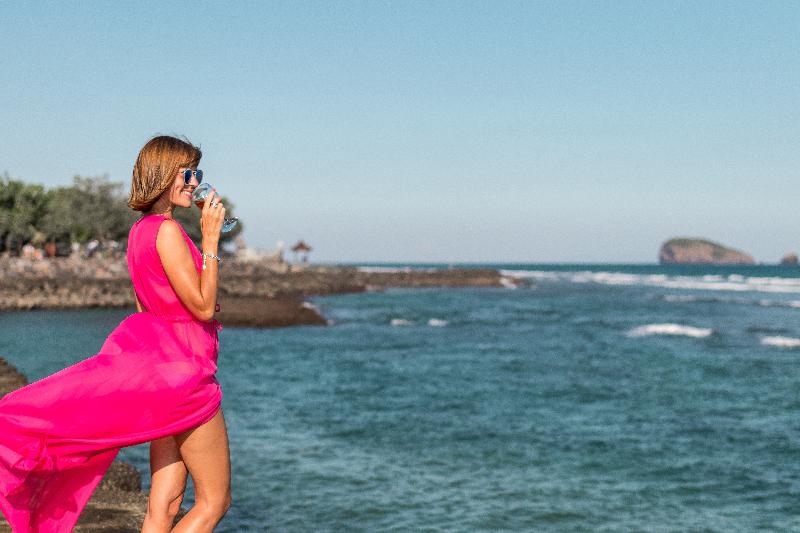 woman-in-pink-dress-waterside